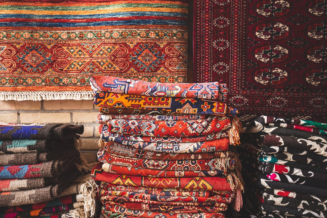Carpets and textiles folded in market in Bukhara
