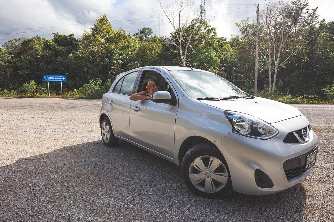 Sindhya sits in car on Ruta de los Cenotes in Puerto Morelos