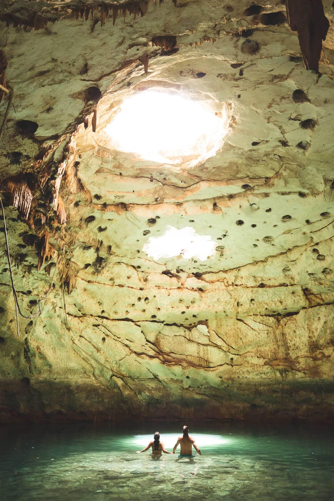 Matt and Sindhya stand inside Hool Kosom cenote