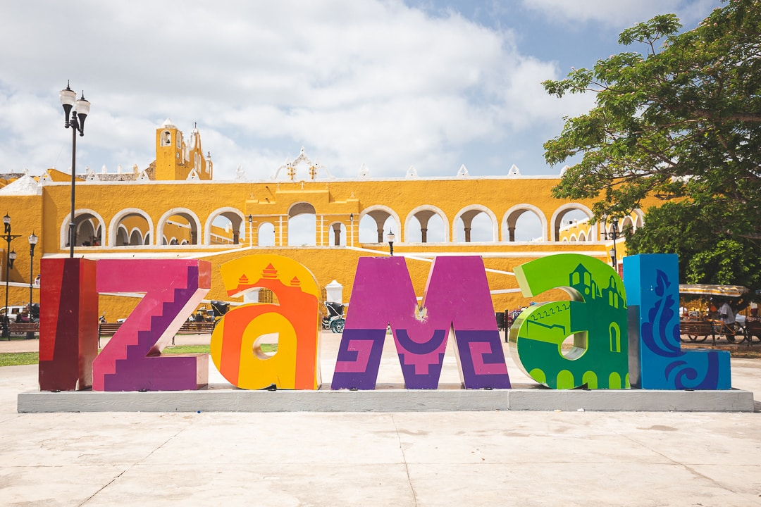 Izamal sign with San Antonio de Padua convent in background in Izamal