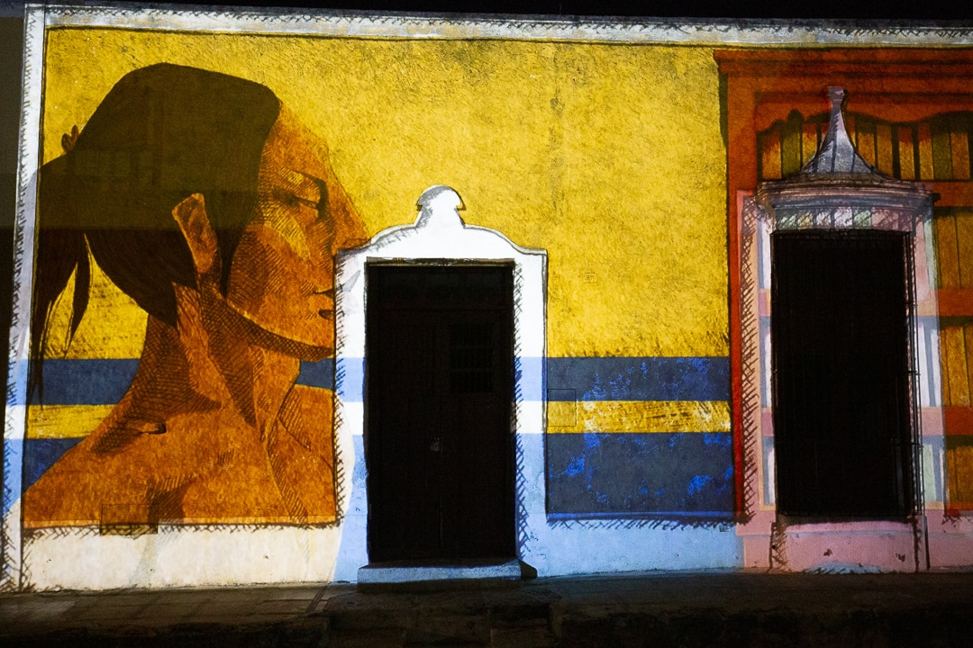 Video mapping show against a wall in Izamal, Mexico