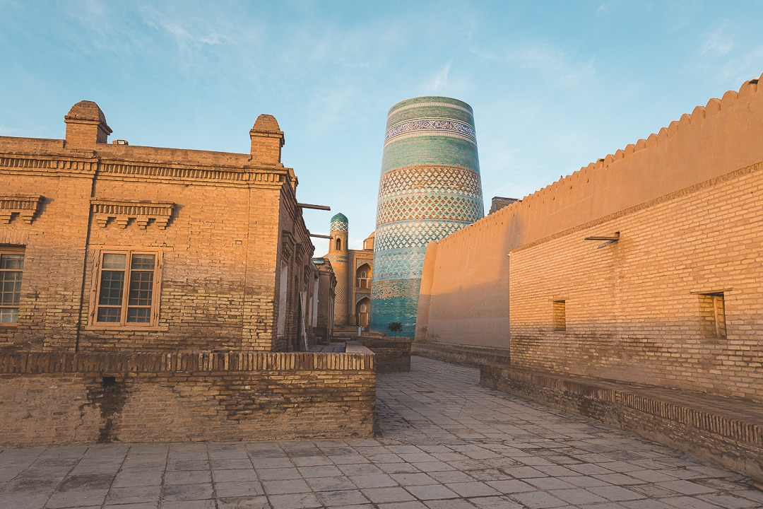 View of the Kalta-minor minaret shortly after sunrise in Khiva, Uzbekistan