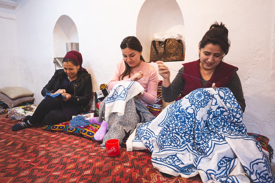 Women working on embroidery at UNESCO Khiva Silk Road Workshop in Uzbekistan