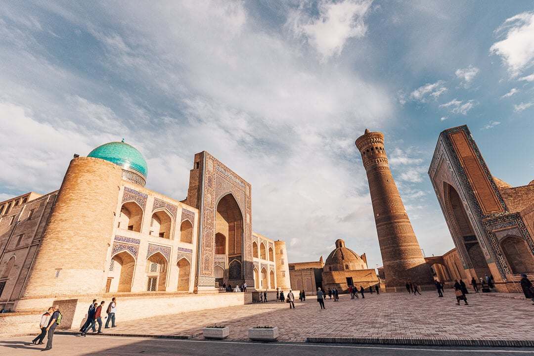 View of Mir-i-Arab madrassa, Kalyan minaret and mosque from the Poi-Kalyan complex. Things to know Uzbekistan travel guide.