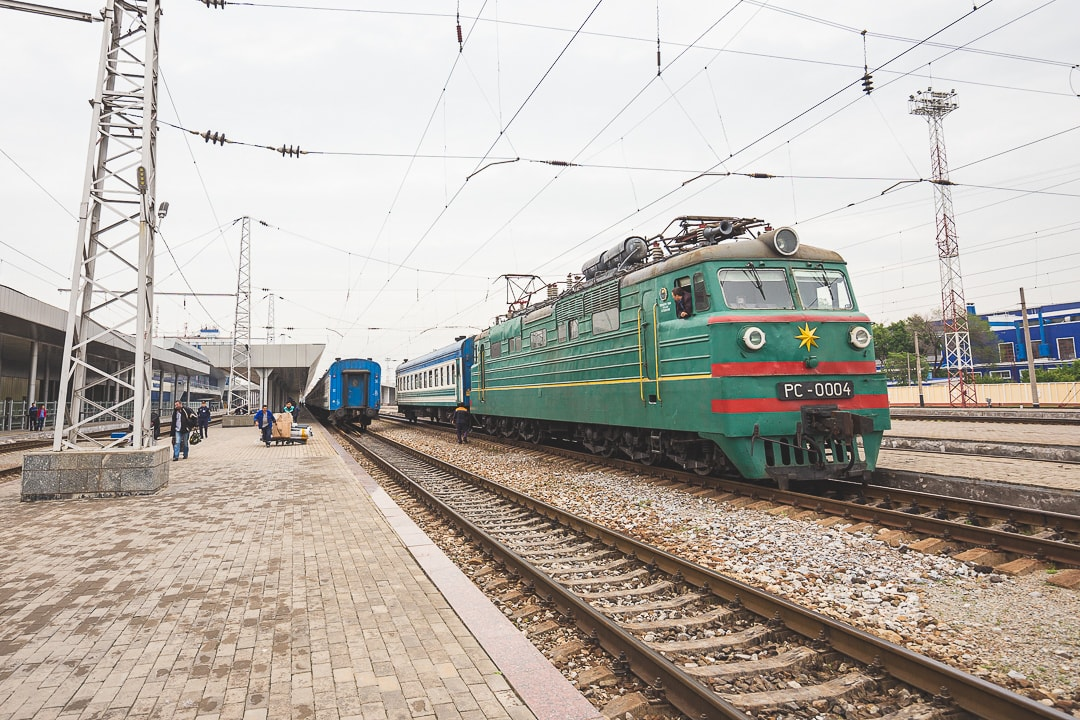 Soviet train on tracks in Uzbekistan.