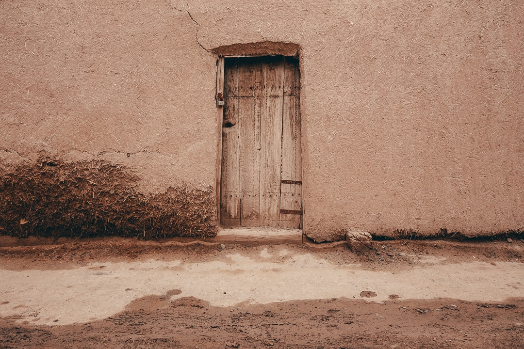 Wooden door of a mud building inside the Itchan Kala.