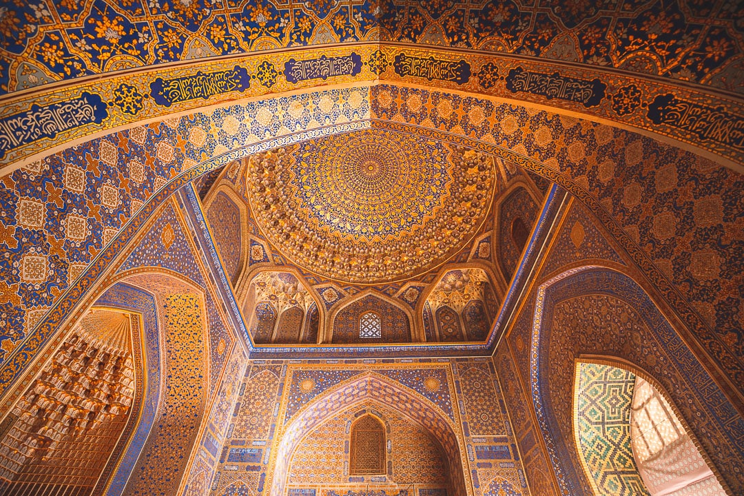 Gold interior of the dome of the Tilya Kori Mosque at the Registan