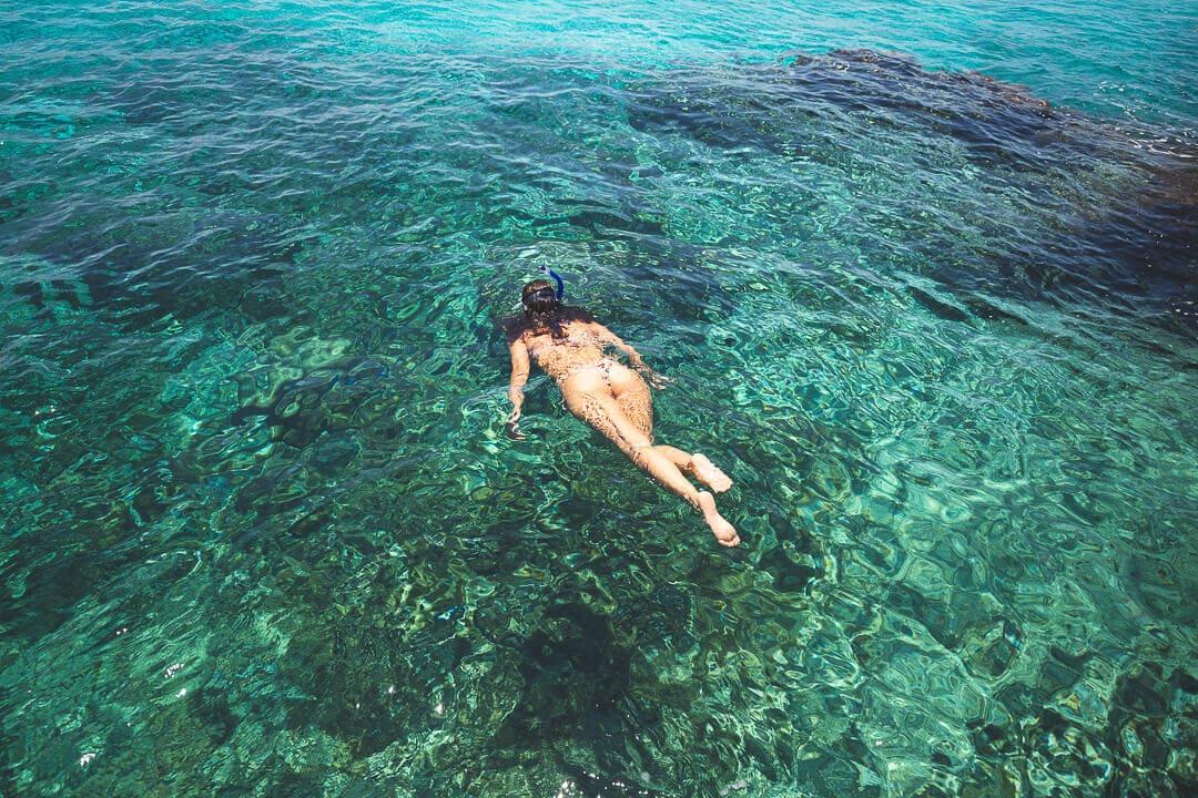 Sindhya snorkeling in emerald water in Cozumel, Mexico.