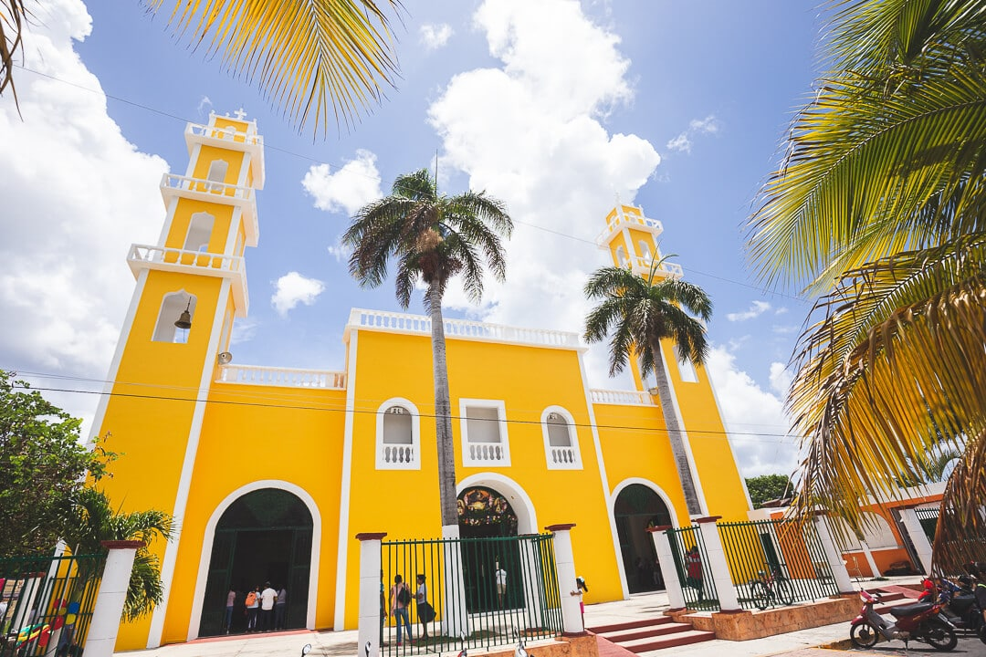 The Cathedral of Corpus Christi surrounded by palm trees in Cozumel, Mexico