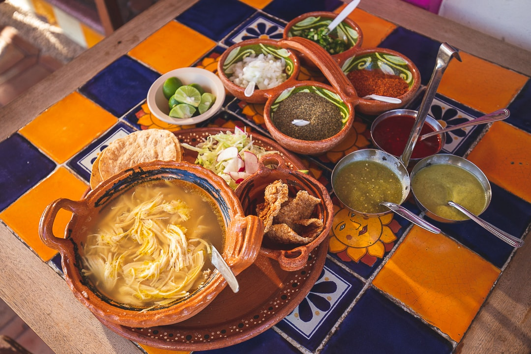 Pozole blanco with condiments.