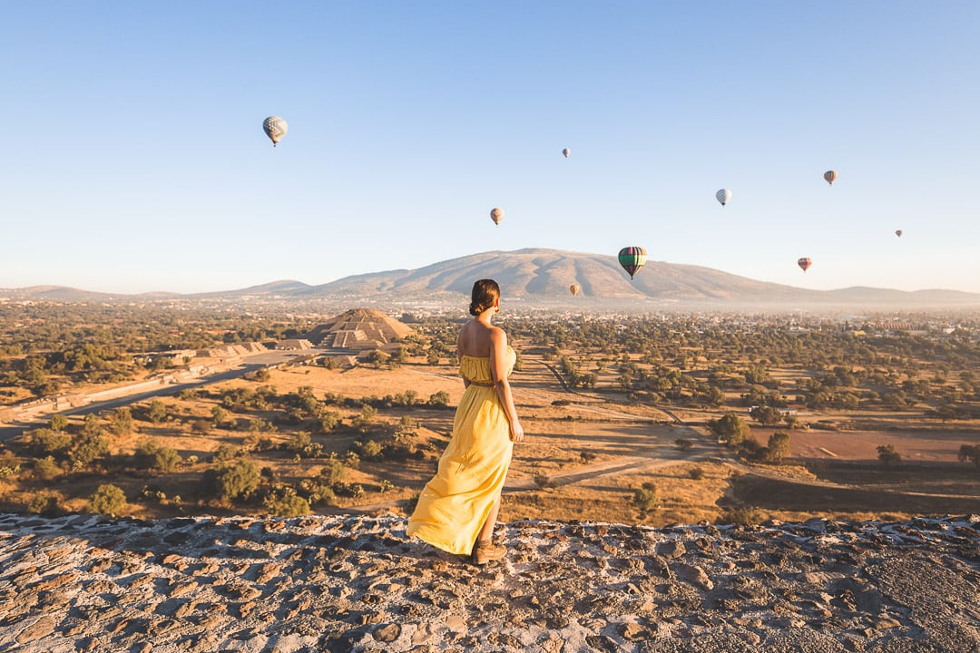 Sunrise at Teotihuacan's Pyramid of the Sun with hot air ballons flying by...