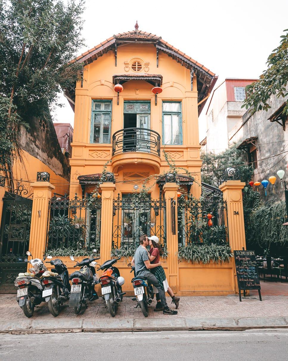 Couple kissing in front of Home restaurant in Hanoi, Vietnam